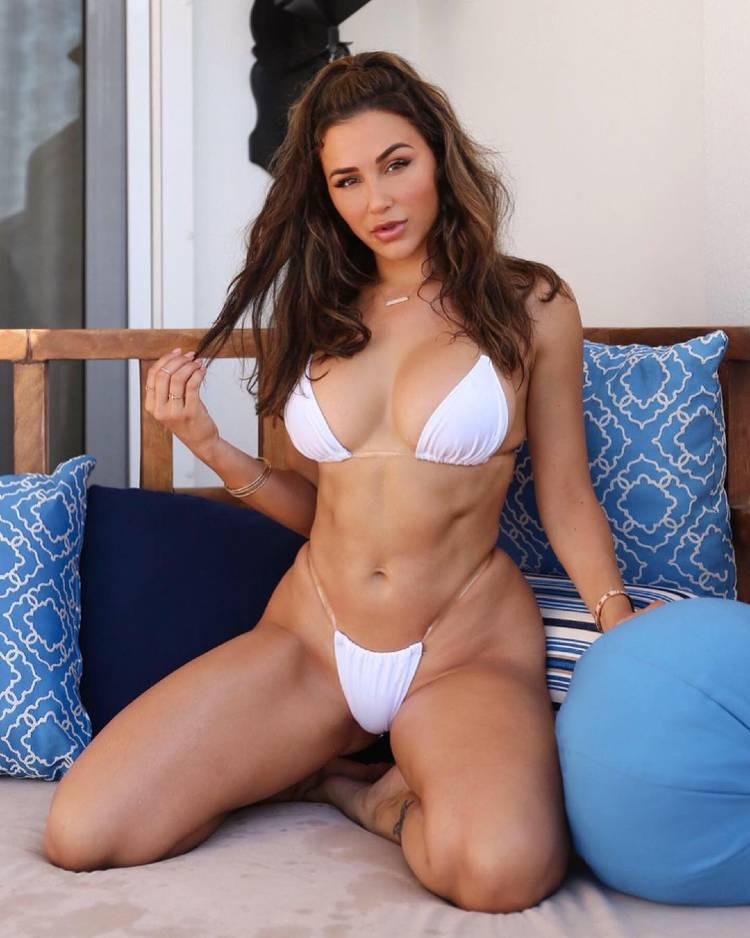 Ana Cheri posing in her white bikini, looking toned and curvy