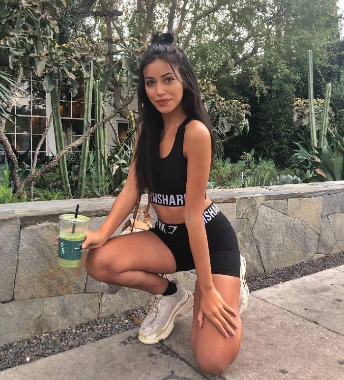 Cindy Kimberly posing in a sportsuit