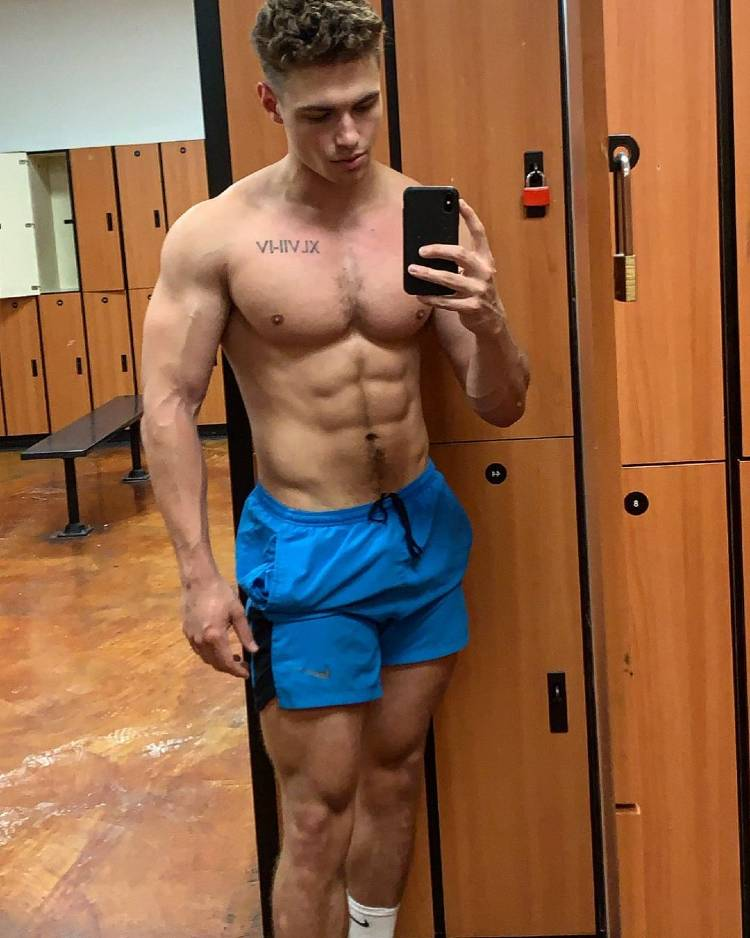 Colton Wergin taking a selfie in a gym locer room