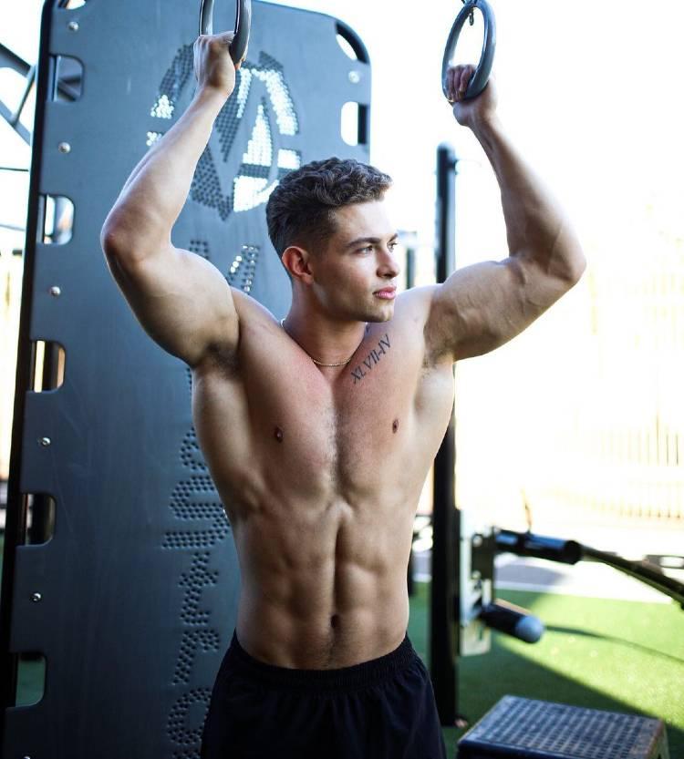 Colton Wergin posing shirtless in a modeling photo shoot