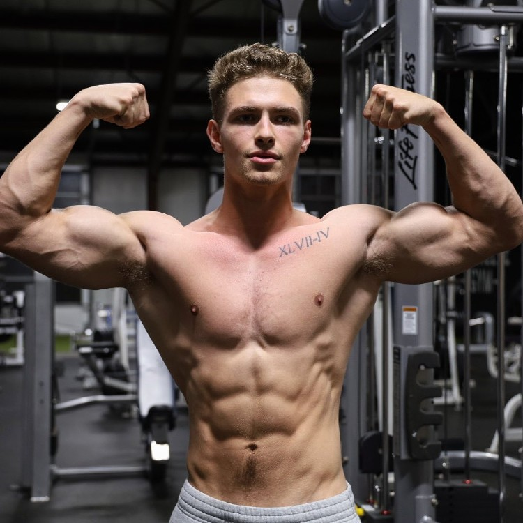 Colton Wergin hitting a front double biceps pose.