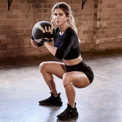 Sophie Guidolin doing a squat with a ball between her hands