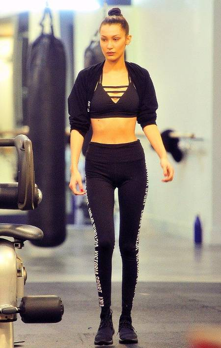 Bella Hadid walking in the gym looking fir and lean