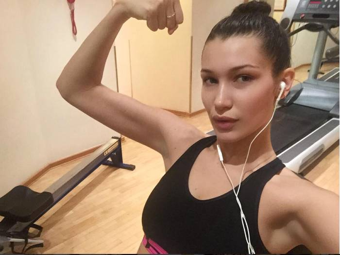 Bella Hadid flexing her biceps in the gym