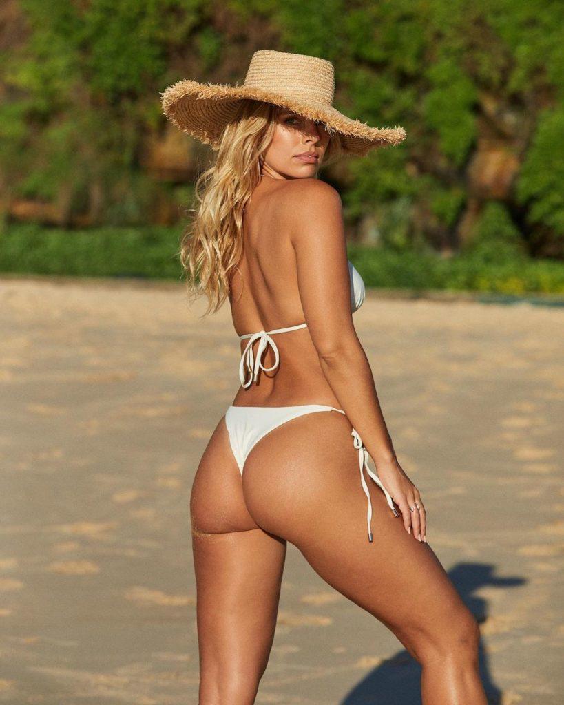 Natasha Oakley showing off her lean beach body and awesome glutes in a white bikini.
