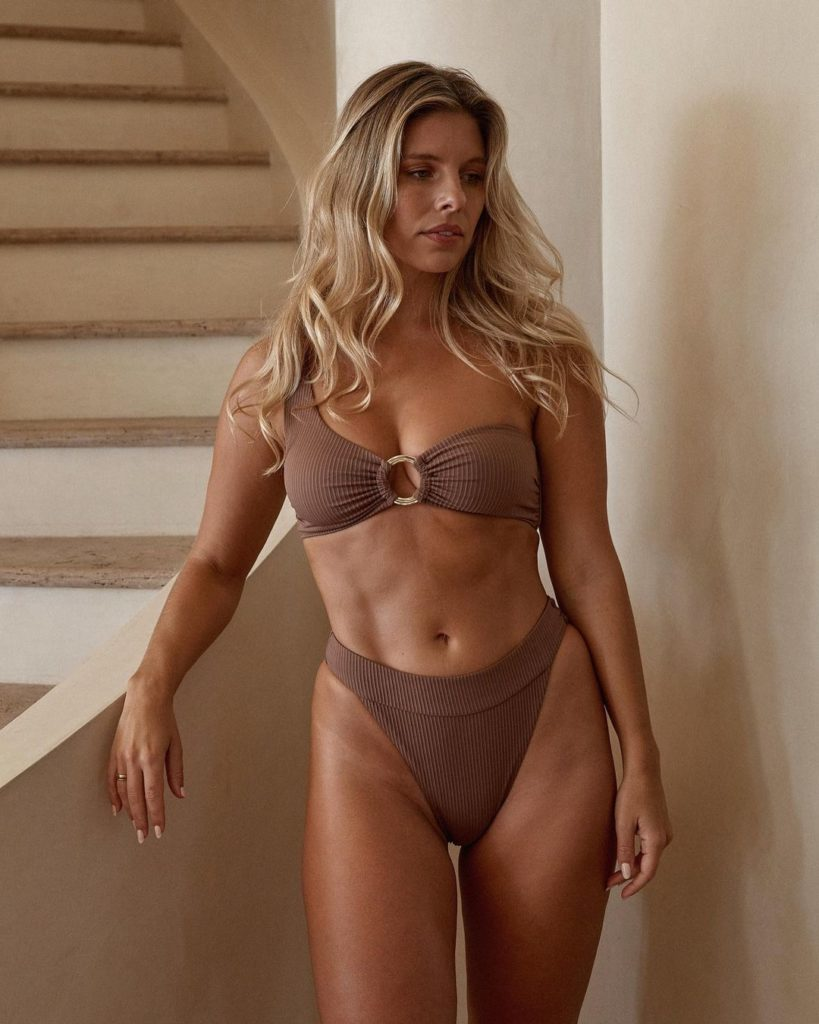 Natasha Oakley showing off her lean and fit body for a photo shoot.