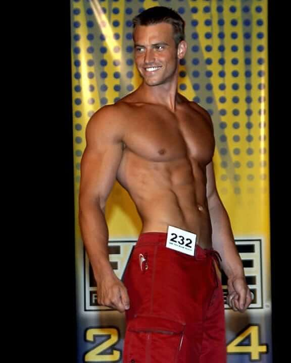 Nick Auger posing with his ripped physique during a fitness competition.