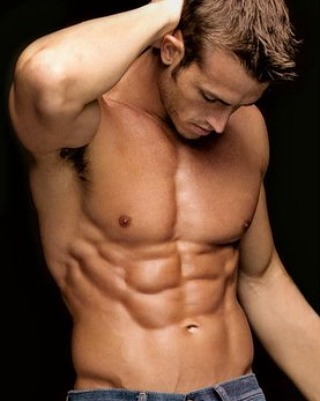 Nick Auger posing shirtless with his shredded abs.